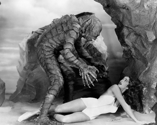 "The ""Gill-Man"" can't wait to get a hold of Julia Adams In ""The Creature from the Black Lagoon."""
